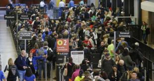 Passengers wait to go through security screening at a TSA checkpoint. Photo courtesy of NBC.