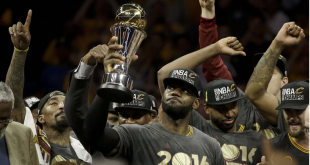 LeBron James hoisting his NBA Finals MVP Trophy as he led the Cavs to their first NBA Championship and his third. Photo from ESPN.