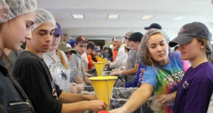 Students getting involved at the Stop Hunger Now food drive, sponsored by PHHS Interact club. Photo via @PHHS_PRINCIPLE on Twitter.