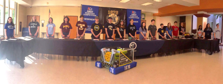Signing away to college with the help of robots