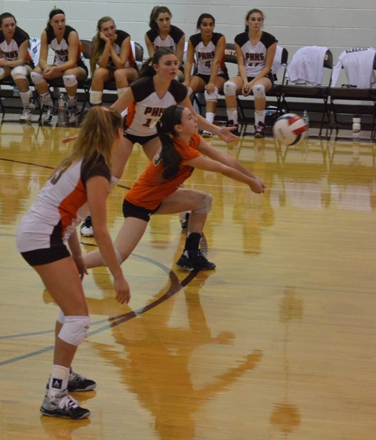 Junior Jamie Spelling digs the volleyball to help her team to the win