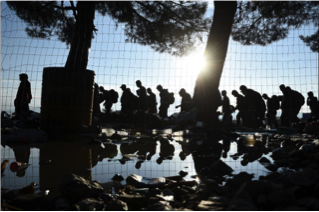 On Friday, September 11, migrants walk from northern Greece into southern Macedonia.
