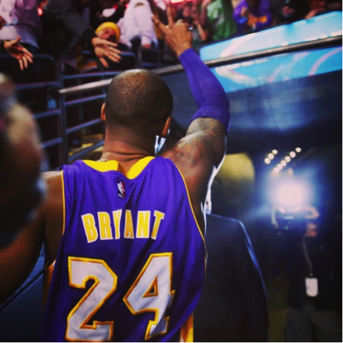 Kobe waves to the Boston crowd before stepping off the TD Garden floor one last time. Photo from ESPN
