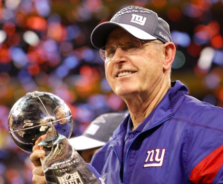 Tom Coughlin celebrating one of his two Super Bowl victories. (ESPN.com)