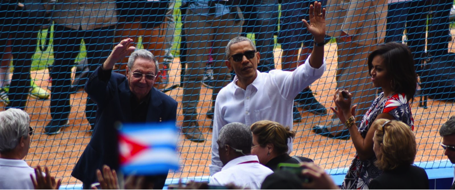 President Barack Obama (Right) and Cuban President Raul Castro (Left) wave to the crowd before the first pitch between a Major league team and a Cuban international team in over 15 years  (abcnews.go.com).