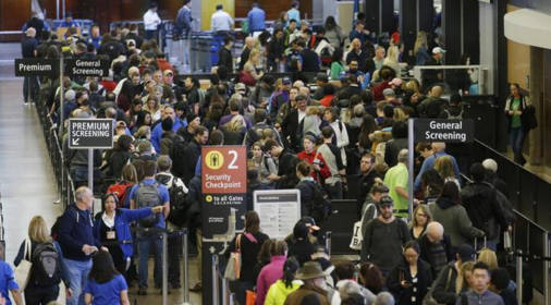 Passengers wait to go through security screening at a TSA checkpoint. Photo courtesy of NBC.
