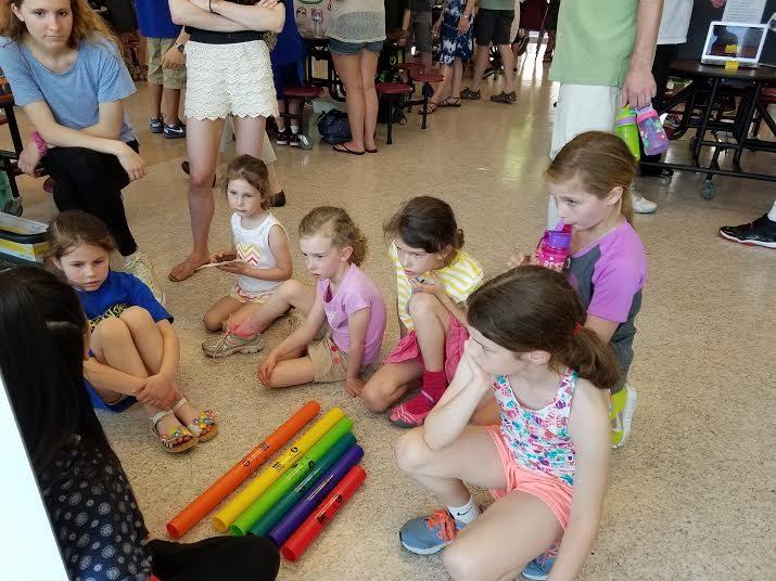 Elementary school children watch a Physics Exploratorium presentation  on sound waves |Photo by Tim Wieland