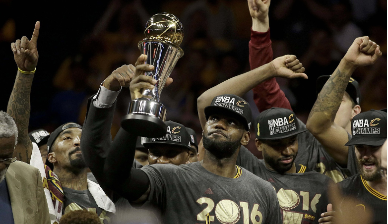 LeBron+James+hoisting+his+NBA+Finals+MVP+Trophy+as+he+led+the+Cavs+to+their+first+NBA+Championship+and+his+third.+Photo+from+ESPN.