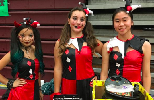 Jade Siegel (left), Olivia Izzo and Miranda Luo pose as Harlequinns for the Fieldstone Halloween carnival. (Photo by Jade Siegel)