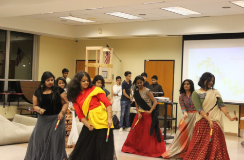 Exchange students perform traditional dance