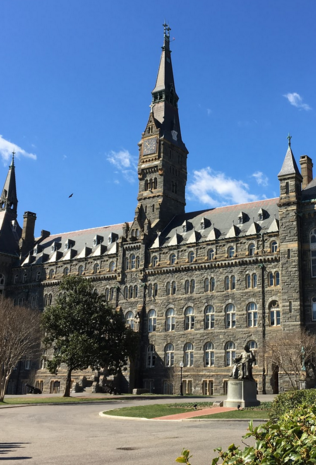 Healy Hall, a national historical landmark, located in front of the main entrance, Healy Gates. A statue of Bishop John Caroll, founder of Georgetown University, is seen center. Photo by Kyle Hammalian.