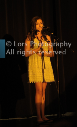 Gianna singing at the 2017 Talent Night. Photo by LORS Photography.