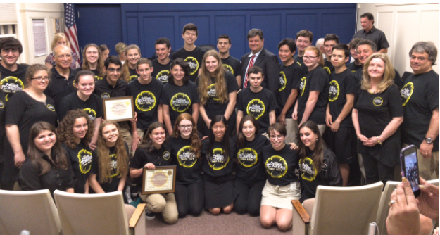 Team members and mentors pictured with Woodcliff Lake Mayor and the CEOs' certificates. Photo by: Team 1676