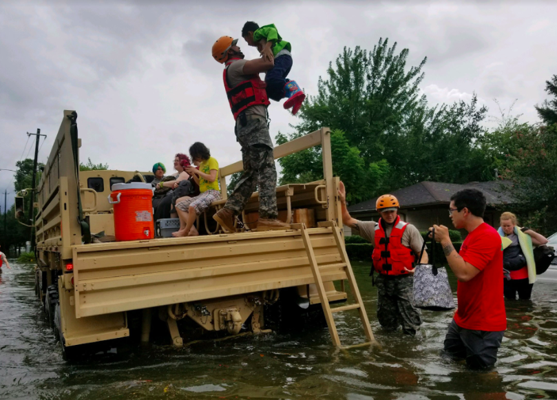 National+Guardsmen+rescue+stranded+residents+from+flooded+areas+following+Hurricane+Harvey.+Photo+Courtesy+of+the+DoD.