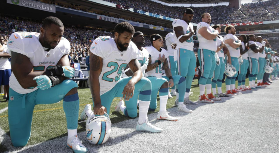 NFL+teams+across+the+league+like+the+Dolphins+took+a+knee+during+the+National+Anthem.+