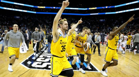 UMBC walks off the court after taking down the number one overall seed. Photo by sportingnews.com.