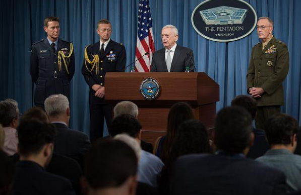 Defense Secretary Mattis and Chairman of the Joint Chiefs of Staff General Dunford brief reporters alongside French and British attachés during a joint press conference at the Pentagon (Photo courtesy of DOD).