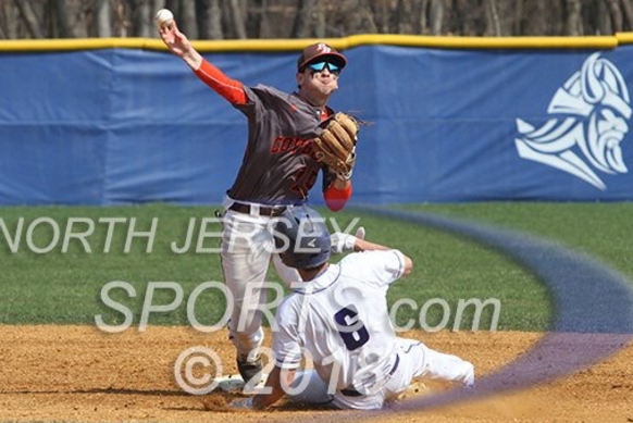 Bulzomi Turning a Double Play against Demarest. Photo Credits: northjerseysports.com