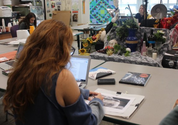 Junior Gillian Herzberger works hard on a project for AP Studio Art.