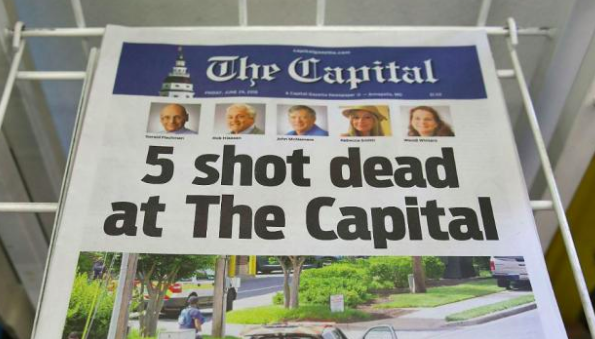Photo Credit: Getty Images A photo of the Capital Gazette publishing a newspaper the day after the shooting about the victims and tragedy.