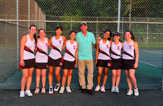 The Girls varsity tennis team poses after a win against Ramsey