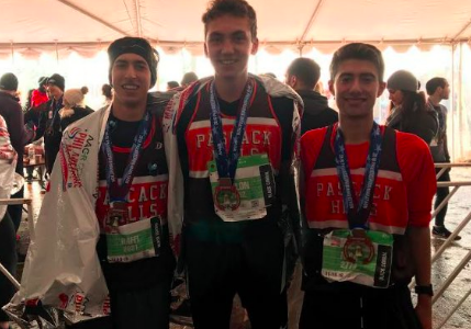 Left to right: Raffi Najarian, Dillon Jensen, and Nick Michelis after finishing the marathon in their Hills uniforms