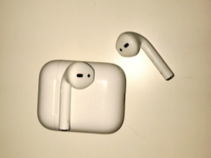 A pair of AirPods and their case