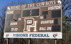 The football scoreboard on Pascack Hills' field. The top of the board reads