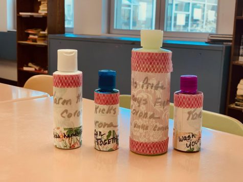 "A set of custom hand sanitizers made by Ms. Pfleging and her mom to prevent spread of the virus. The writing on the bottles include reminders to ""wash your hands"" and ""cowboys fight corona."""