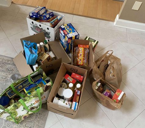 Donations collected at a contactless food drive drop-off site hosted by National Honors Society member Alec Boyajian. The organization is seeking to safely help local food pantries and those who are in need.