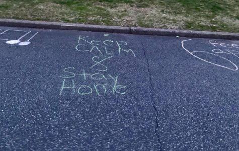 A chalk creation in Woodcliff Lake reminding residents to stay home. During quarantine, families have adjusted to the increased time spent together.