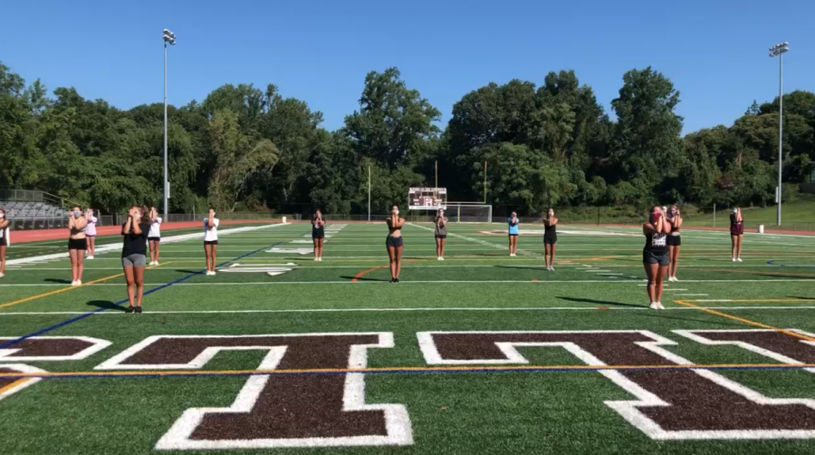 The Hills cheerleading team practices on August 24. Pre-season practice recently resumed for many Hills student-athletes.