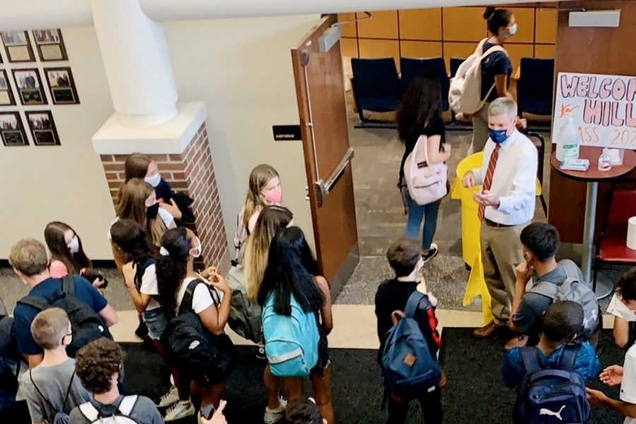 Principal Tim Wieland directs freshmen to their classes during orientation Sept. 3.