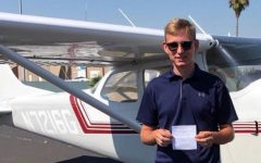 Rising senior Alex Nasano with his pilot's license, which he received over the summer.