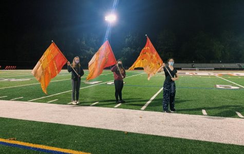 The color guard at practice. On Oct. 2, the group was revived under the direction of Mr. Ryan Dore and Ms. Adria Warfield. From left: Giuliana Balboni, Scianna Scott, and Rachael Lokshin.