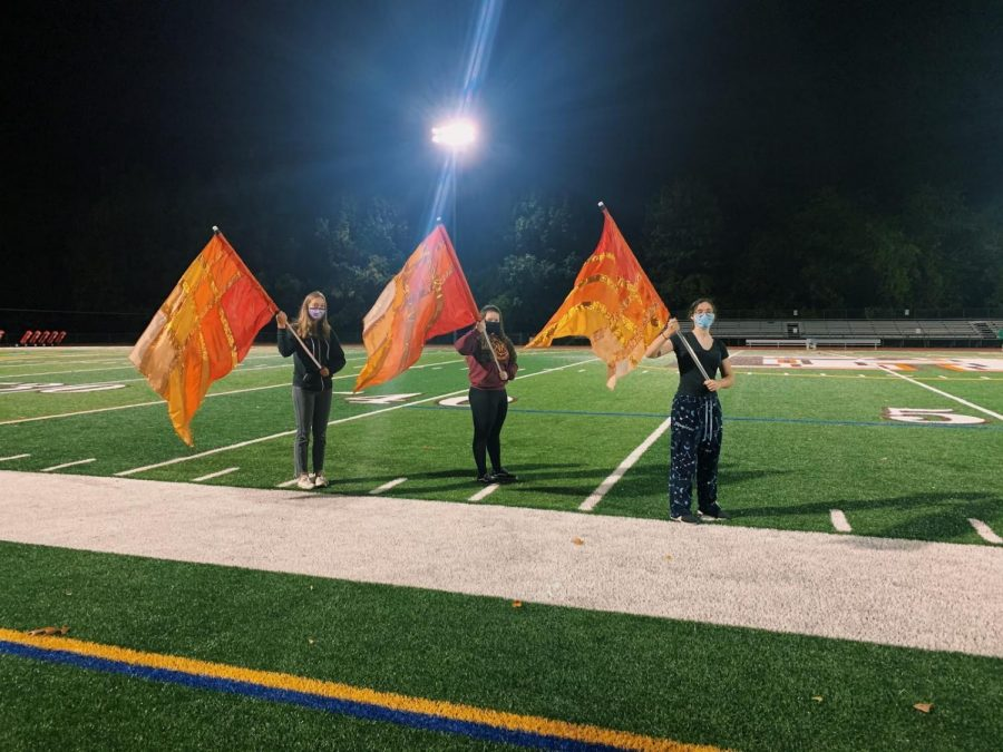 The+color+guard+at+practice.+On+Oct.+2%2C+the+group+was+revived+under+the+direction+of+Mr.+Ryan+Dore+and+Ms.+Adria+Warfield.+From+left%3A+Giuliana+Balboni%2C+Scianna+Scott%2C+and+Rachael+Lokshin.+