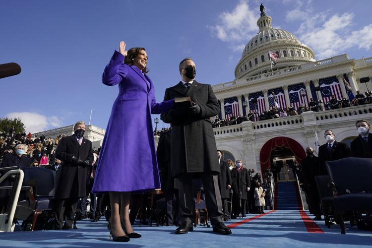 Vice President Kamala Harris, wearing purple, is sworn in at the 2021 presidential inauguration.