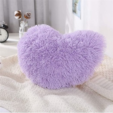 Heart plush pillow: Not only is this pillow a perfect gift but it's also perfect for room decor. It shows that you care while also giving her something that she will use in the future. Link to buy