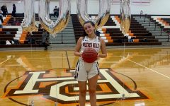 McNierney poses for a photo after scoring her 1,000th point.