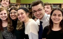 Members of this year's debate team pictured at a tournament in December 2019.