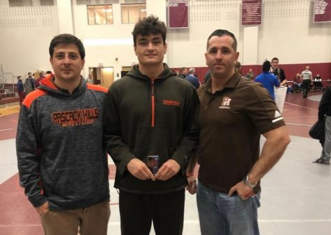 Alex Kostantas, middle, holding his state medal next to Coach Dave Bucco, left, and Coach Kevin Moran, right.