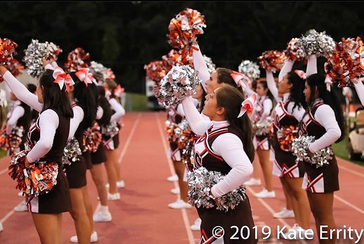 According to guidelines, both football and cheerleading hold the same risk when it comes to exposure to the coronavirus. But according to state regulations for winter sports, cheer teams are deemed non-essential at basketball games.
