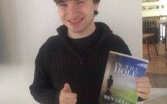 Levin holding a copy of In the Hole, published by Jumpmaster Press.