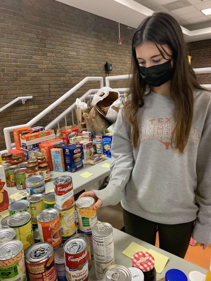 Hills junior Karya Acar sorting soup donations.