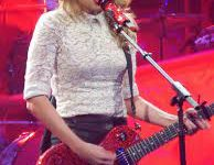 Taylor Swift on her Red tour (photo licensed by Creative Commons)